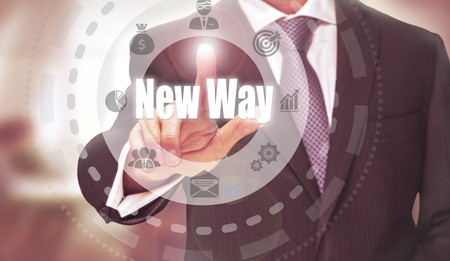 new way: Businessman pressing an New Way concept button. Stock Photo