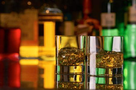 Glasses of single malt whisky on a bar.