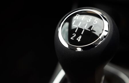 gearstick: A closeup of a black and silver car gear stick Stock Photo