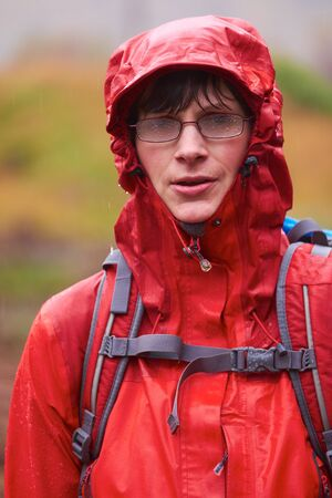 glen: Very wet hiker with misted glasses.  Glen Etive, Scottish Highlands. Stock Photo