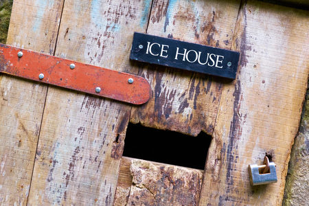 old english: An old rustic door leading to the Ice House Cellar in on an English Estate.