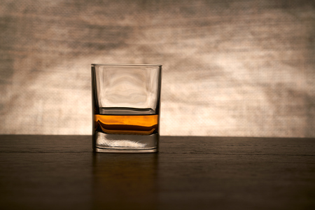bar top: A glass of whisky on a wood bar top. Stock Photo