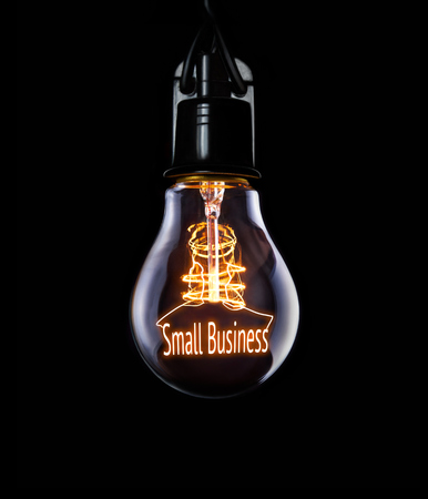 company ownership: Lightbulb Small Business Concept Stock Photo
