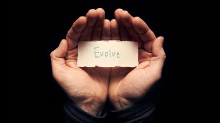evolve: A man holding a torn piece of paper with a Evolve Concept