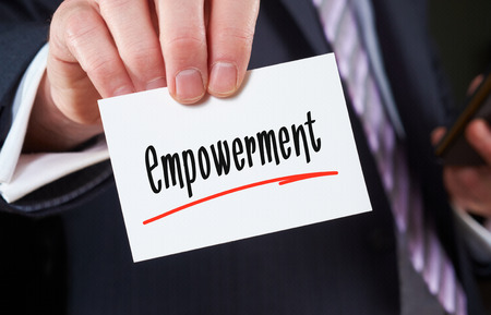 endow: A man holding a Business card Empowerment Concept Stock Photo