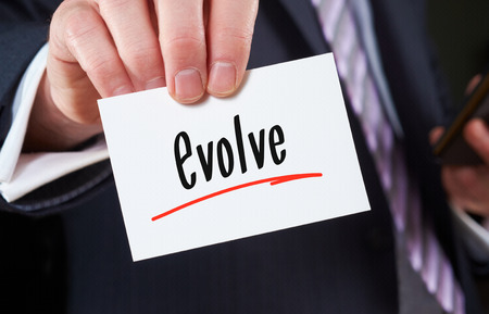 holding business card: A man holding Business card Evolve Concept