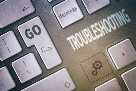 solucion de problemas: Close up of a keyboard with a Troubleshooting concept. Foto de archivo