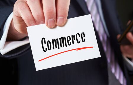 card commerce: A man holding a Business card Commerce Concept