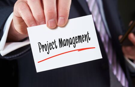 constrain: A man holding a Business card Project Management Concept