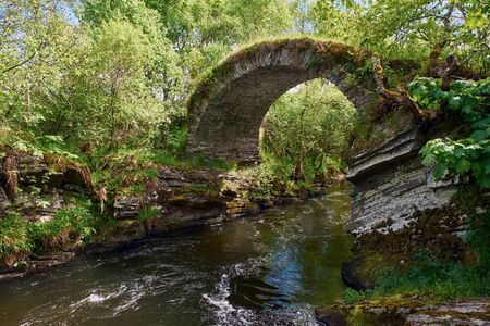 The remains of The Old Bridge of Livet that crosses the river Livet in the Scottish Highlands.UK.