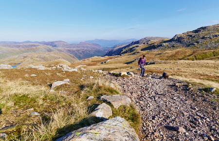 A hiker walking up from Seathwaite, Grains Gill  in the English Lake District. UK. Stock Photo
