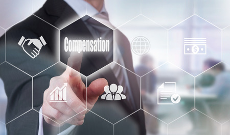compensated: A businessman selecting a Compensation Concept button on a clear screen. Stock Photo