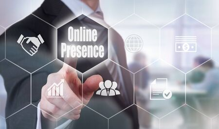 bookmarking: A businessman selecting a Online Presence Concept button on a clear screen. Stock Photo