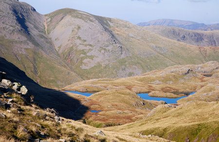 lakeland: Views of Sprinking Tarn near the shadows of Great End in the English Lake District. UK.