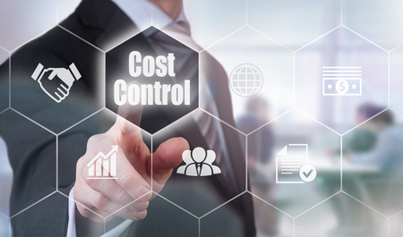 price cutting: A businessman selecting a Cost Control Concept button on a clear screen. Stock Photo