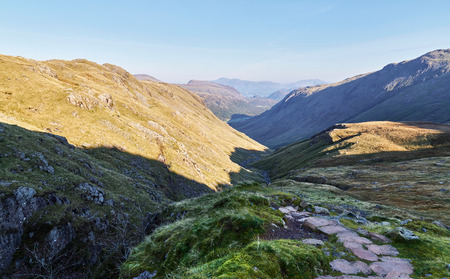 View of Grains Gill and towards Seathwaite from the path leading to Scafell Pike in the English Lake District. UK.