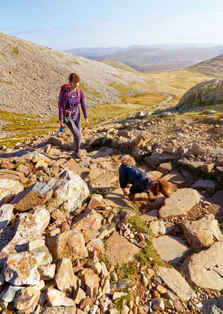 gill: A hiker walking up from Seathwaite, Grains Gill towards Scafell Pike in the English Lake District. UK.