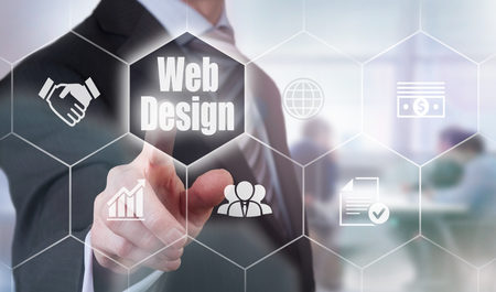 web presence internet presence: A businessman selecting a Web Design Concept button on a clear screen. Stock Photo
