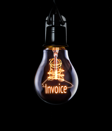 Hanging lightbulb with glowing Invoice concept. Stock Photo