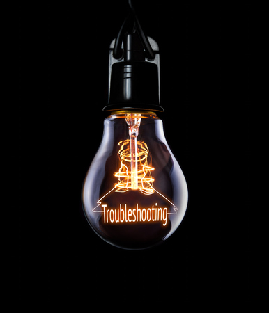 solucion de problemas: Hanging lightbulb with glowing Troubleshooting concept.