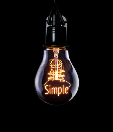 eslogan: Colgando bombilla con brillantes concepto simple. Foto de archivo