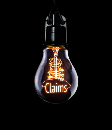 Hanging lightbulb with glowing Claims concept.