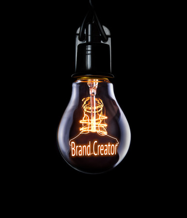 Hanging lightbulb with glowing Brand Creator concept.