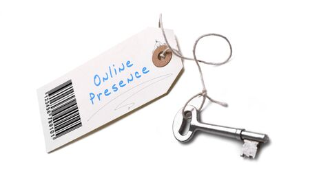 A silver key with a tag attached with a Online Presence concept written on it.