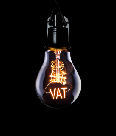 Hanging lightbulb with glowing VAT concept.