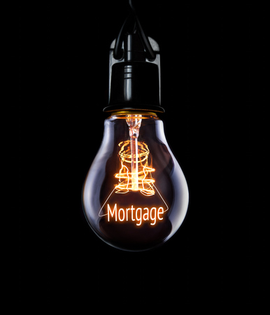 underwriter: Hanging lightbulb with glowing Mortgage concept.