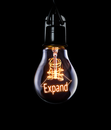 Hanging lightbulb with glowing Expand concept.
