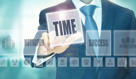 modernise: Businessman pressing an Time concept button. Stock Photo