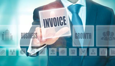A businessman pressing an Invoice button on a transparent screen.