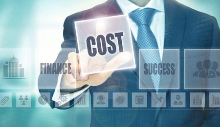 economise: Businessman pressing an Cost concept button.