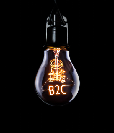Hanging lightbulb with glowing B2C concept.