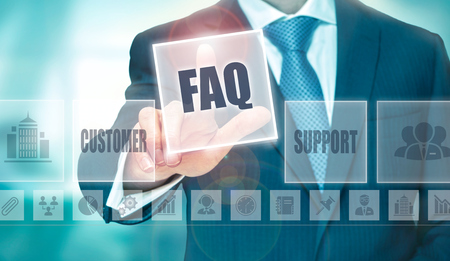 questions: A businessman selecting a Frequently Asked Questions Concept button on a clear screen.
