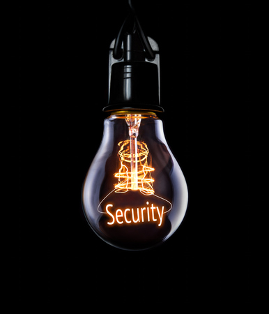 Hanging lightbulb with glowing Security concept.
