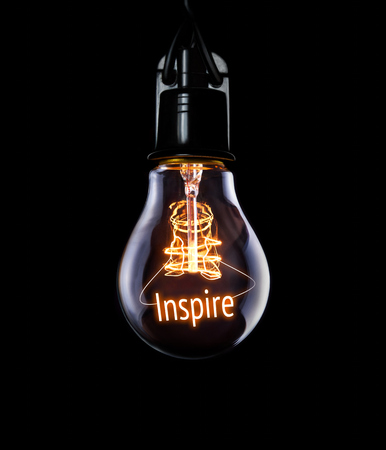 energize: Hanging lightbulb with glowing Inspire concept.