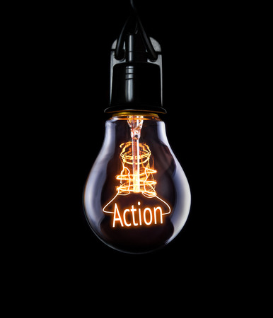 Hanging lightbulb with glowing Action concept.