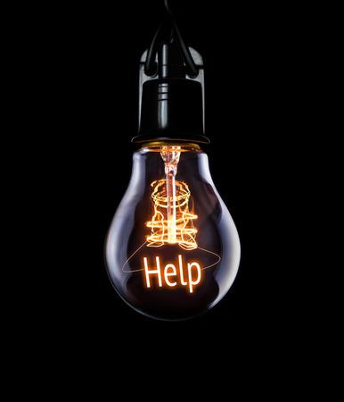 Hanging lightbulb with glowing Help concept. Reklamní fotografie