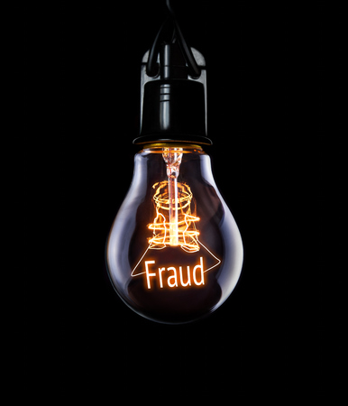 swindling: Hanging lightbulb with glowing Fraud concept. Stock Photo