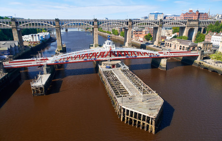 NEWCASTLE UPON TYNE, ENGLAND, UK - AUGUST 13, 2015: The Swing & High Level bridges over the river Tyne at Newcastle. Editorial