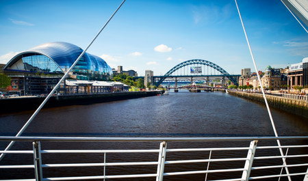 NEWCASTLE UPON TYNE, ENGLAND, UK - AUGUST 13, 2015: The Tyne Bridge, Sage and Quayside from the Millennium Bridge in Newcastle.