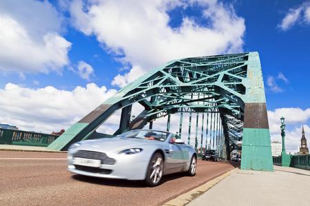 NEWCASTLE UPON TYNE QUAYSIDE, ENGLAND, UK - APRIL 26, 2013: Traffic crossing the Tyne Bridge at Newcastle Upon Tyne. Editorial