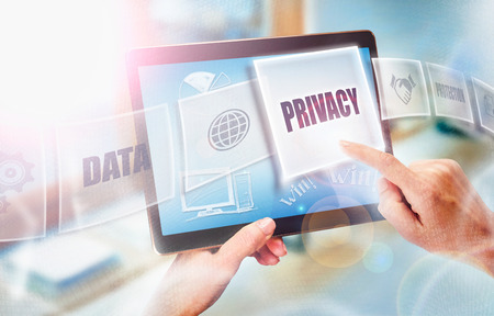 internet search: A businesswoman selecting a Privacy business concept on a futuristic portable computer screen. Stock Photo