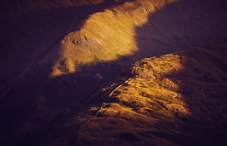 lake district: Sunsetting over mountain ridges in the English Lake District, UK.