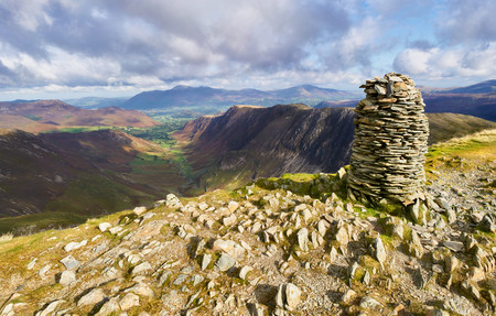ridgeline: Views of Newlands Beck, High Spy, Narrow Moor and Maiden Moor in the Derwent Fells from the summit Cairn of Dale Head, Lake District, England, UK.