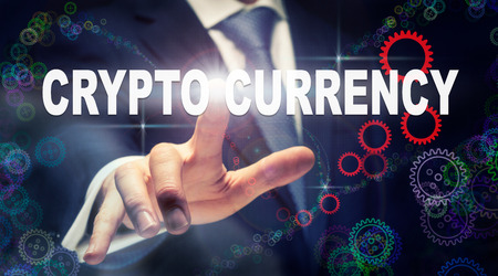 A businessman pressing a Crypto Currency business concept on a graphical display of cogs
