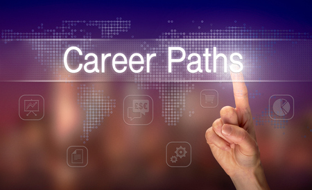 A hand selecting a Career Paths business concept on a clear screen with a colorful blurred background.