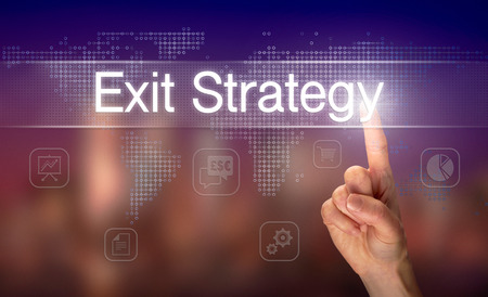 A hand selecting a Exit Strategy business concept on a clear screen with a colorful blurred background.